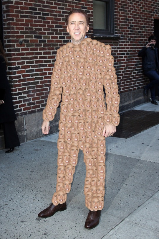 """Nicolas Cage poses for photographers outside of the """"Late Show with David Letterman"""" in New York"""